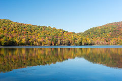 Hertel Lake in Quebec with Autumn colors Stock Image