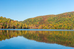 Hertel Lake in Quebec with Autumn colors Royalty Free Stock Images