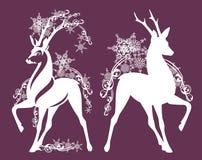 Herten onder sneeuwvlokkendecor Royalty-vrije Stock Afbeelding