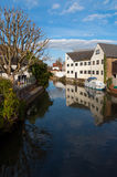 Hertford, England, houses by the river, blue sky with reflection Royalty Free Stock Image