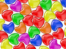 Herts colored. Valentine's Day celebration concept: colors glossy shiny lolipop in the form  of heart  isolated on white background Stock Image