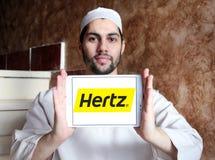 Hertz car rental logo. Logo of hertz car rental company on samsung tablet holded by arab muslim man stock photos