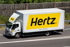 Mitsubishi Fuso Canter of Hertz on motorway. The Hertz Corporation is an American car rental company based in Estero, Florida royalty free stock images