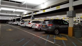 Hertz Rental Car. Sterling, Virginia, United States - September 25, 2016:  Rows of cars at night at the Hertz Car Rental Center at Dulles International Airport Stock Images