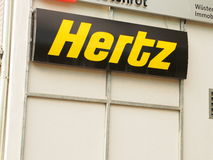 Hertz sign. Hertz is the american based biggest car rental company in the world Royalty Free Stock Photo