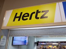 Hertz sign. Hertz car rental sign at airport rental desk at Tenerife airport Royalty Free Stock Photography