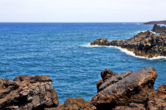 Hervideros brown rock in white coast lanzarote    ummer Stock Photography