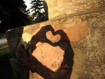 Herz über Hände Stockfoto
