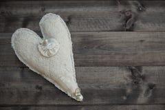 Herz auf der Planke Stockfotos