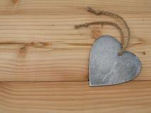 Herz auf einem Brett lizenzfreies stockfoto
