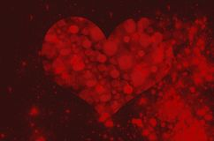 Herz auf einem Hintergrund eines roten sternenklaren Himmels Lizenzfreie Stockfotografie