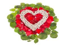 Herz auf rosigem Bett Lizenzfreies Stockfoto