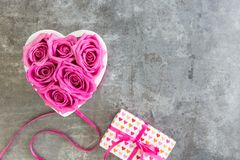 Heart of roses in pink and gift box with bow, Mother`s Day stock photos