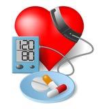 Herz-Blutdruckmonitor und -pillen Stockfotos