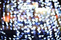 Herz bokeh Hintergrund Goldinnere auf Rot Stockfotografie