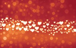 Herz bokeh Hintergrund Vibrierende glänzende Herzen auf reizendem bokeh Hintergrund lizenzfreie abbildung