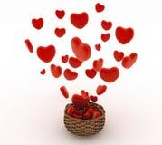 Herz, das in einen Weidenkorb fällt Das Konzept eines Geschenks mit Liebe Lizenzfreie Stockbilder