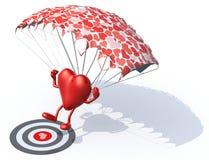 Herz, das mit Fallschirm auf einem targe landet Lizenzfreies Stockbild