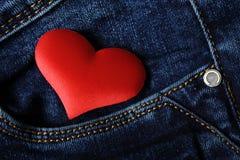Herz in der Tasche Stockbild