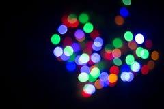 Herz des Lichtes lampen Nahtloses geschlungen verschiedene Farben Auf einem blac Lizenzfreies Stockfoto