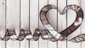 Herz des Zelluloids auf weißer Planke Stockbilder