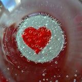Herz in einem Glas Stockfoto