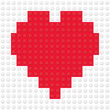 Herz-Form geschaffen von den Gebäudespielzeugziegelsteinen Stockfoto