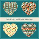 Herz-Formen mit geometrischem Schmutz-Hintergrund Lizenzfreies Stockfoto