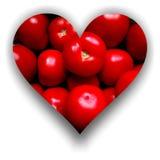 Herz gefüllt mit Tomaten Stockfotos