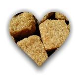 Herz gemacht von den brauner Zuckerwürfeln Stockbild
