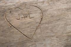 Herz geschnitten in Holz Lizenzfreies Stockfoto