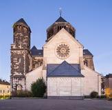 Herz-Jesu Church in Aachen, Germany at night. Side view of the catholic Herz-Jesu church in Aachen Burtscheid, Germany with night blue sky stock image