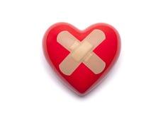 Herz mit Heftpflaster Stockbild