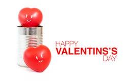 Herz mit Lächelngefühl in der Blechdose und im glücklichen Valentinstag wo Stockbilder