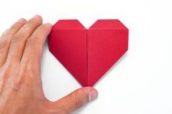 Herz-Origami-Hand Stockbilder