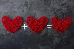 Herz plus Herz ist Liebe gleich Thema für St.-Valentinsgruß ` s Tag Lizenzfreies Stockfoto