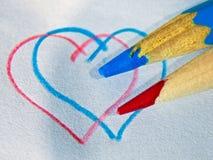 Herz und pensil lizenzfreie stockbilder