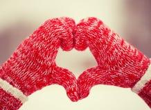 Herz von Handschuhen Stockfoto