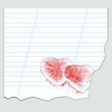 Herzen auf einem Blatt des Notizbuches Stockfotos