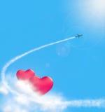 Herzen in den Wolken und airplan Lizenzfreie Stockbilder