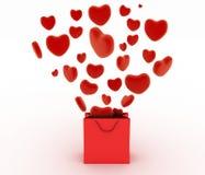 Herzen, die als Geschenke in einem Taschensupermarkt fallen Das Konzept eines Geschenks mit Liebe Lizenzfreies Stockfoto