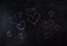 Herzen und neues Jahr 2016, zacken gemalt aus Lizenzfreie Stockfotos