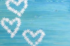 Herzen und Schneeflocken Stockbild