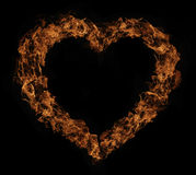 Herzform-Feuerflammen Stockfotos