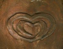 Herzform im Sandstein Stockfoto