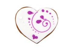 Herzform-Ingwerplätzchen mit weißer und rosa Zuckerglasur Lizenzfreies Stockbild