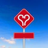 Herzform mit PfeilVerkehrsschild Lizenzfreie Stockbilder