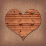Herzform vom hölzernen Schreibtisch stockbild