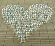 Herzform von transparenten Bällen lizenzfreies stockfoto