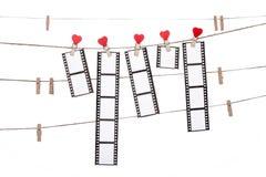 Herzformclip auf einer Schnur, hängende Negative, Liebesfilm Stockfotografie
